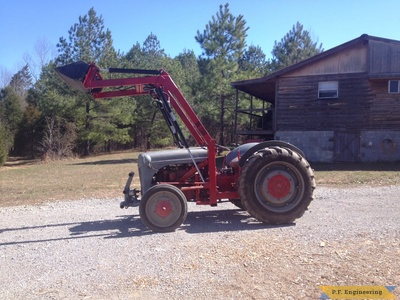 Ford 9N loader bucket raised