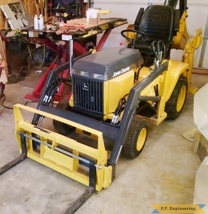 John Deere 318 Micro Hoe Loader with Pallet forks by Jake T.
