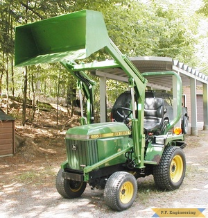 john deere 655 compact tractor loader with bucket raised